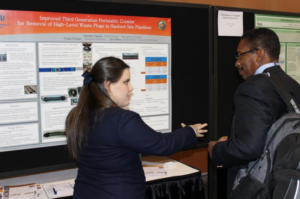 DOE Fellow Gabriela Vazquez presenting her research at the Waste Management Symposium in 2013 to Mr. Desi Crouther (Director - DOE EM Office of Human Capital)