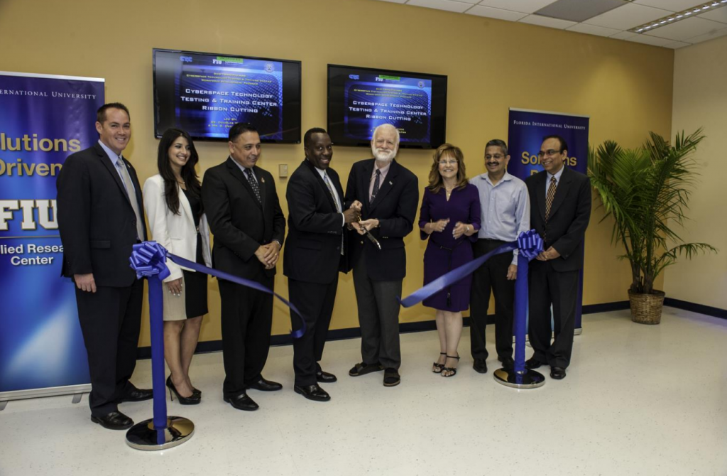 From left to right: Mr. Brian Fonseca (Director of Operations, ARC), Ms. Alessandra Monetti (Engineer, SRC in support of TRMC), Dr. Leonel Lagos (CT3C Program Director and Director of Research, ARC), Mr. G. Derrick Hinton, SES (Principal Deputy Director, TRMC), Dr. Douglas Wartzok (Provost & Executive Vice President, FIU), Dr. Inés Triay (Executive Director, ARC), Dr. Shekhar Bhansali (Chair, Electrical and Computer Engineering Department, FIU), Mr. Himanshu Upadhyay (IT Program Manager, ARC)