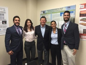 FIU STEM Students and DOE Fellows (Aref, Kiara, Christine, and Christian) with Indian River State College President, Dr. Edwin Massey