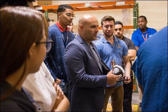 JP Pabon of EM's Technology Development Office joined Florida International University students and Savannah River National Laboratory representatives in a demonstration of fixative techniques for radioactive materials.